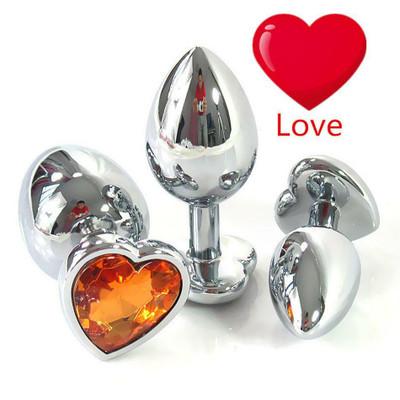 Metal anal plug with orange diamond Large