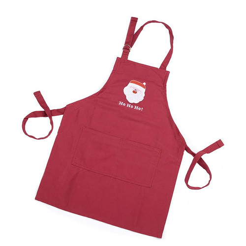 red child's apron with santa claus decal  and HoHoHo writing