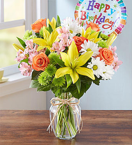Fields of Europe Happy Birthday Brighten somebody's birthday with our beautiful best-selling arrangement. Inspired by the hand-tied bouquets found in European flower markets, this festive gathering of blooms, designed inside a glass vase and tied with raffia, is paired with a cheerful balloon to take their celebration to new heights.