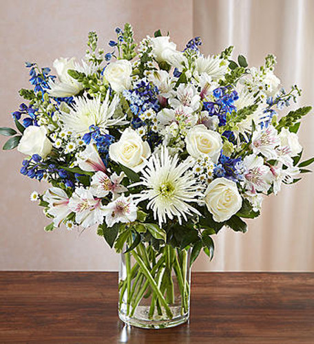 Sincerest Sorrow Blue & White A sincerity of sentiment means so much to those grieving. Our bountiful, heavenly blue and white bouquet features a soothing mix of blue delphinium, alstroemeria, and white roses, hand-designed inside a classic clear glass vase. When sent to a service or to the home of family or friends, it makes a genuinely heartwarming gesture.