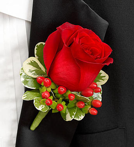 All Red Boutonniere A classic red rose, red hypericum and variegated pittosporum are hand-crafted by our select florists to accent their tuxedos with charm and elegance.