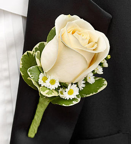 White Boutonniere A classic white rose, white Monte casino and variegated pittosporum are hand-crafted by our select florists to accent their tuxedos with timeless elegance.