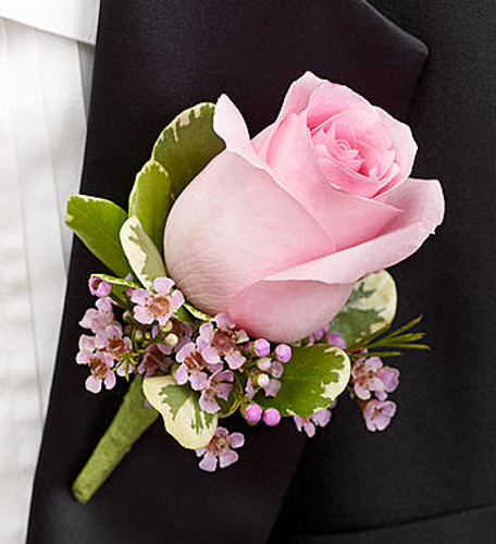 Pink Boutonniere A charming pink rose, pink waxflower and variegated pittosporum creates an elegant boutonniere for the groom, ushers, fathers, grandfathers, or treasured relatives.