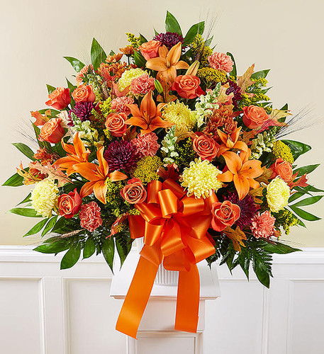 EXCLUSIVE The loss of a loved one is never easy, but we find hope and light in thoughtful and caring gestures. Our classic standing basket arrangement is a warm reminder that brighter days are ahead. Handcrafted by expert local florists with an abundance of blooms in rich autumn colors, it is a touching tribute to a special family member or friend.