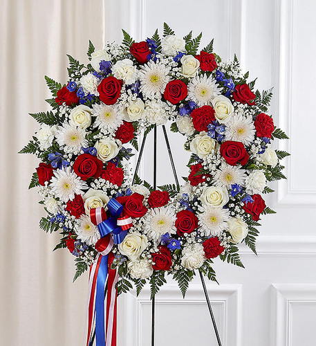 They served their country with honor and pride, so it's only fitting to honor them with a beautiful symbol of eternal life. Our patriotic standing wreath arrangement is meticulously crafted by our expert florists to honor a brave veteran who has passed away. Filled with lush blooms in red, white and blue, it's a fitting final tribute for the funeral services.