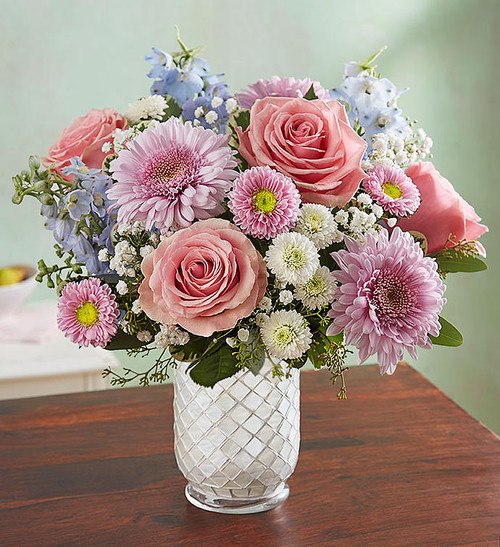 EXCLUSIVE Our new Floral Melody arrangement will have them singing a happy tune. A medley of blush-colored blooms come together inside our striking white glass mosaic vase, featuring a diagonal pattern that dazzles in the light. Later, our exclusive container stands out as a centerpiece or as an eye-catching candle holder¦tea light included!