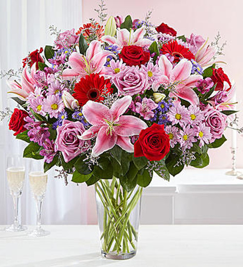 For the one you adore above all else, here's a surprise designed to wow! Our spectacular arrangement is filled with an abundance of lush blooms in soft & bold shades for an exciting contrast of color. Artistically hand-designed by our expert florists, it's a beautiful gift that expresses the depths of your love.