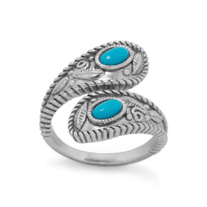 Rhodium plated sterling silver wrap ring with shiny antique finished roping edge and leaf design. The ring has 2 individual reconstituted turquoise stones measuring approximately 3mm x 5mm. This ring is available in whole sizes 5-9 with each size being slightly adjustable.