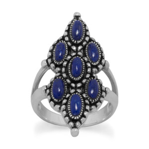 Oxidized sterling silver ring with ornate marquis shape front and 7 individual 2.3mm x 5.7mm lapis stones. The band near the stone is split and merges into one band that measures approximately 3.3mm in the back. This ring is available in whole sizes 6-10.  .925 Sterling Silver