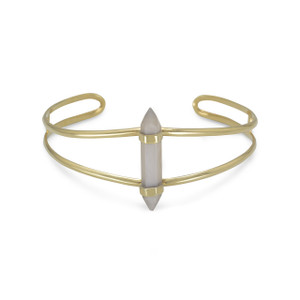 14 karat gold plated sterling silver split style cuff bracelet with gray moonstone spike. The graduated cuff measures approximately 8mm - 17.5mm. The six sided moonstone spike is 5.5mm x 30mm.  .925 Sterling Silver