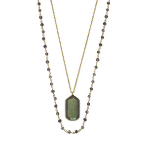 "35"" strand of faceted iolite on 14 karat gold plated wire and a 30"" 14 karat gold plated chain with labradorite drop. The labradorite is approximately 14.5mm x 25mm. The necklace has a lobster clasp closure.  .925 Sterling Silver"