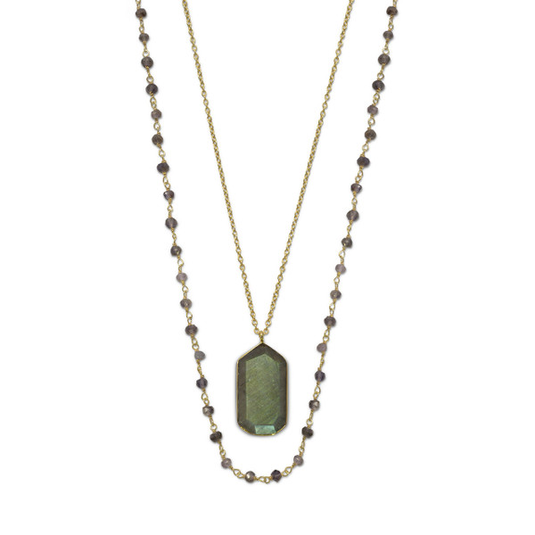 """35"""" strand of faceted iolite on 14 karat gold plated wire and a 30"""" 14 karat gold plated chain with labradorite drop. The labradorite is approximately 14.5mm x 25mm. The necklace has a lobster clasp closure.  .925 Sterling Silver"""