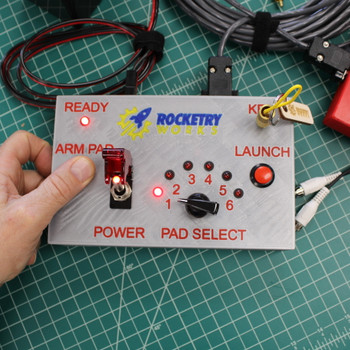 A removable safety key and illuminated power button are both required for use. The rotary switch prevents multiple simultaneous launches (drag races). This is a deliberate safety feature for this controller's intended use in school settings where spectators are not accustomed to range operations.