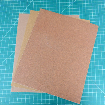 8.5 x 11 inch sheets of sand paper. 220, 120, 80 (left to right).
