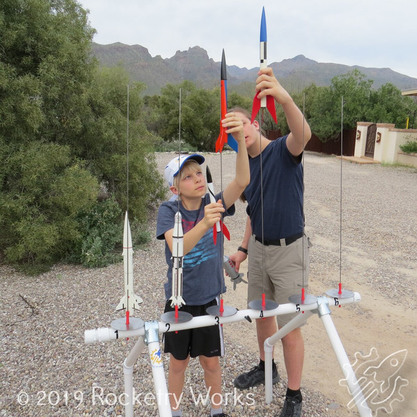 The tall configuration keeps the launch rod tips up above the face of 6 foot tall individuals, yet older elementary age children can load a rocket onto the launch rod without bending the rod.