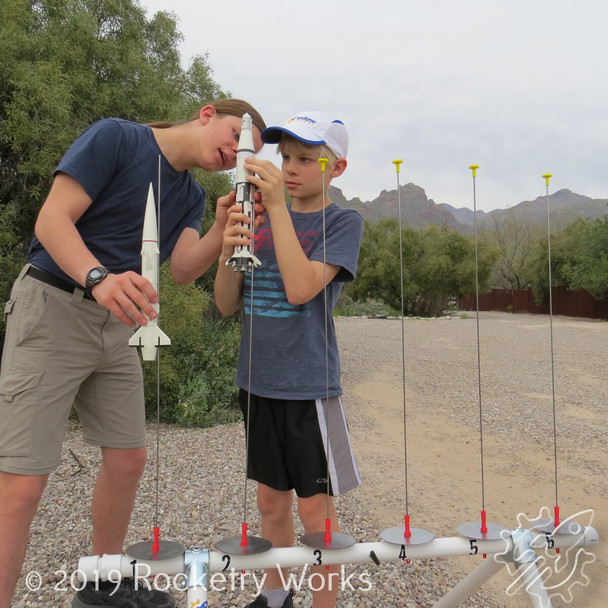 The short configuration allows young elementary age kids to reach the rod tips, but be sure to use the included launch rod caps to protect taller kids and adults.