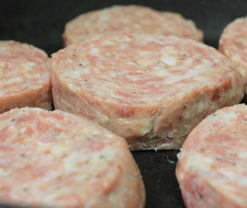 breakfast sausage with bacon in frypan