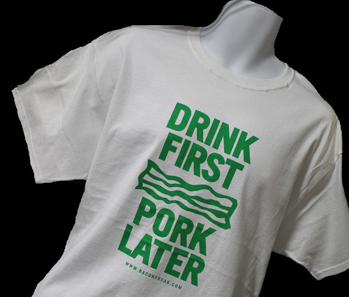 white t-shirt with Drink First Pork Later green type