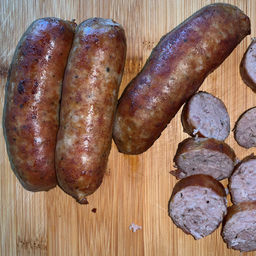 Cooked sweet Italian Sausage links & slices.