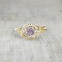 Handmade pink sapphire engagement ring.