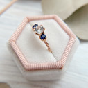 White sapphire engagement ring by Olivia Ewing Jewelry