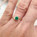 Emerald solitaire twig engagement ring by Olivia Ewing Jewelry