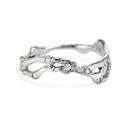 Platinum pavé diamond curved wedding band by Olivia Ewing Jewelry