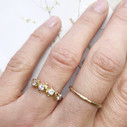 Flower engagement ring by Olivia Ewing Jewelry