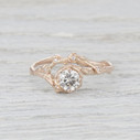 Forever One Moissanite half halo ring