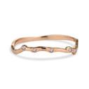 14K rose gold diamond contour band by Olivia Ewing Jewelry