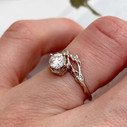 Diamond halo engagement ring in 18K white gold by Olivia Ewing Jewelry