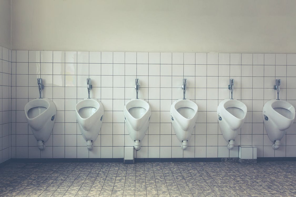 The dense, unpleasant scent of urine. This aroma is not uncommon in men's public toilets, where the odour of splatters has mixed with the stale vapours of dried-up cleaning products.