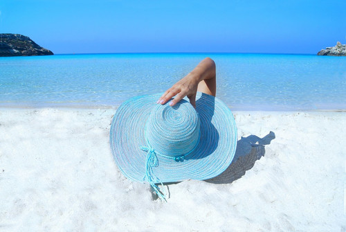 The breeze of the clear blue/green sea lapping on the beach of paradise.