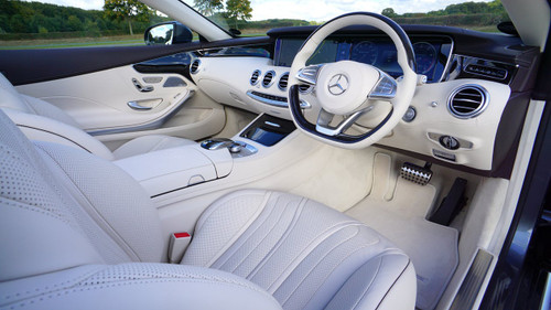 The delicious smell of the soft leather interior of a brand new car.