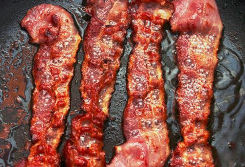 The enticing, smoky aroma of bacon crisping on the grill.