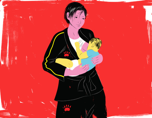 Mother wearing martial arts uniform breastfeeding baby