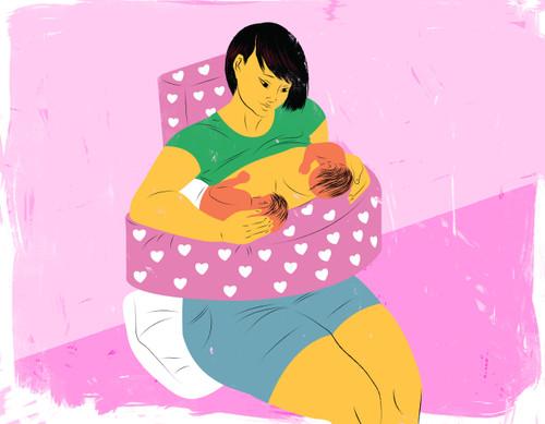 Mother breastfeeding twin babies