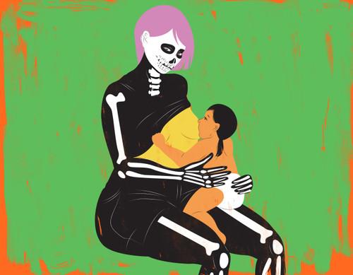 Mother in halloween costume breastfeeding baby