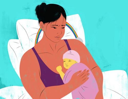 Mother holding newborn rainbow baby