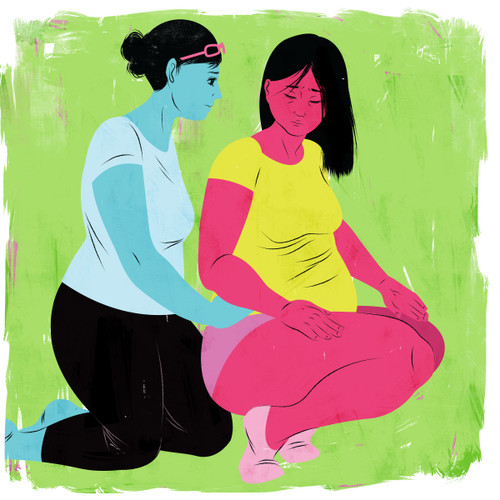 Doula supporting a squatting mother