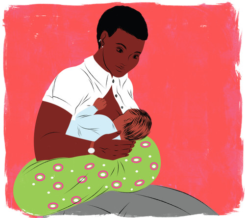 Mother breastfeeding with green nursing pillow