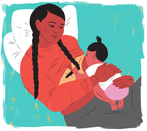 Mother with braided hair breastfeeding baby in the laid back position