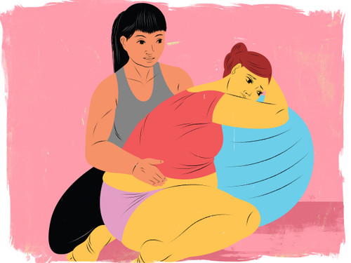 Doula supporting mother using birthing ball