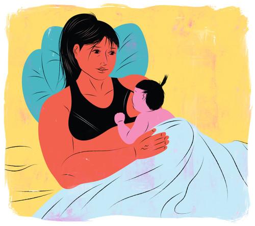 Laid back breastfeeding , smiling mother