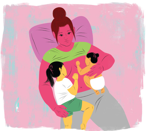 Mother tandem nursing two children
