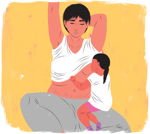 Mother breastfeeding older child while stretching