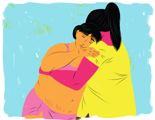 Woman in labor holding on to her Doula