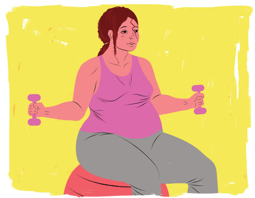 Pregnant woman exercising on ball with dumb bells