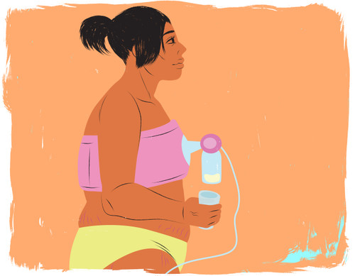 Mother having a drink while pumping breast milk