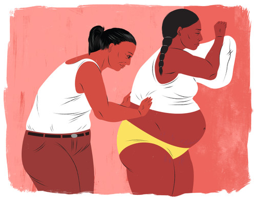 Doula helping mother in labor